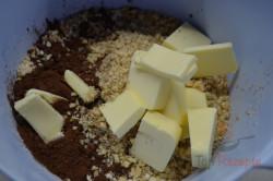 Zubereitung des Rezepts Süße Wurst mit Walnüssen, in Kokos gewälzt, schritt 3