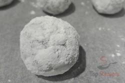 Zubereitung des Rezepts Schoko-Nuss-Kugeln in Puderzucker, schritt 4